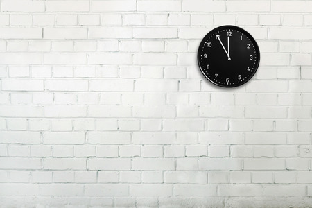 Abstract brick wall with office clock Фото со стока