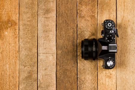 Vintage camera on a wooden background with copy space photo