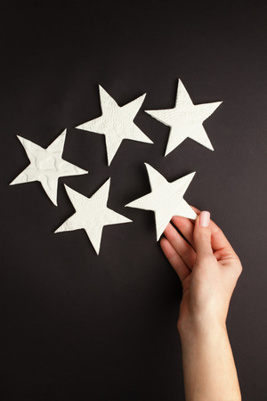 kaolin: Female hands holding little stars made of pottery clay Stock Photo
