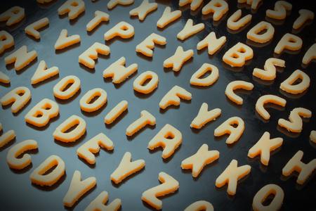 baking tray: Alphabet cookies on baking tray Stock Photo