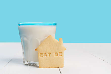 drink me: Glass of milk and biscuits with EAT ME sign