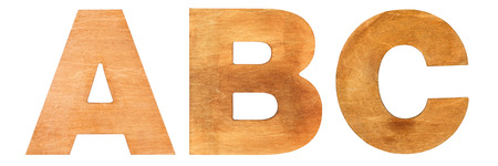 Old wooden letters ABC isolated on white background. One from the full alphabet set