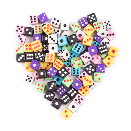Gambling addiction concept. Gaming dice heart symbol isolated on white background. Flat lay