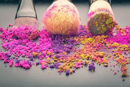 scincare: Make-up brushes on colorful make-up powder