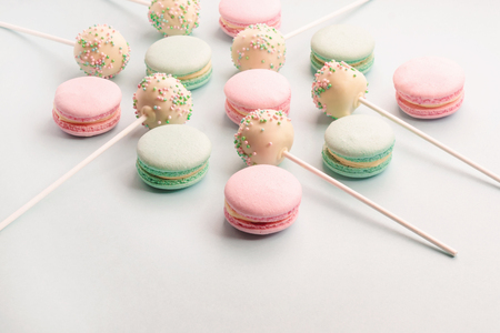 Sweet macarons and cake pops on sticks assortment