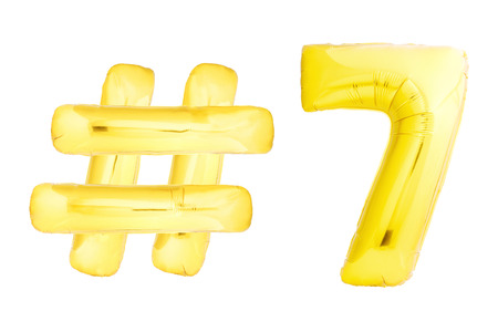 Golden number seven 7 with hashtag symbol helium air balloon isolated on white background