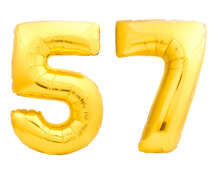 Golden number 57 fifty seven made of inflatable balloon isolated on white background