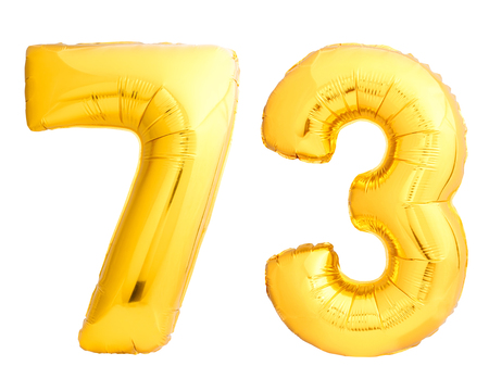 Golden number 73 seventy three made of inflatable balloon isolated on white background