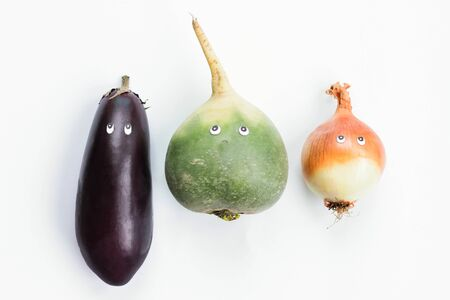 dikon: Food vegetables concept. Eggplant, green radish and leek with cartoon eyes on white background. Funny food concept. Top view