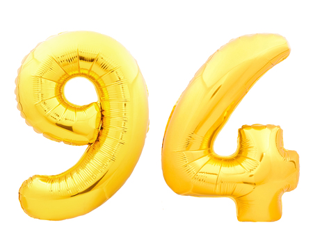 Golden number 94 ninety four made of inflatable balloon isolated on white background