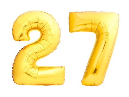 Golden number 27 twenty seven made of inflatable balloon isolated on white background Фото со стока