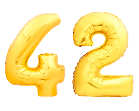 Golden number 42 fourty two made of inflatable balloon isolated on white background Stock Photo