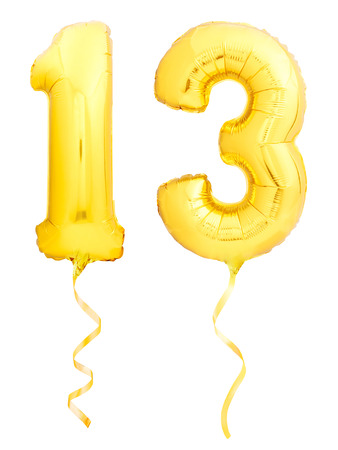 Golden number 13 thirteen made of inflatable balloon with golden ribbon isolated on white background Foto de archivo