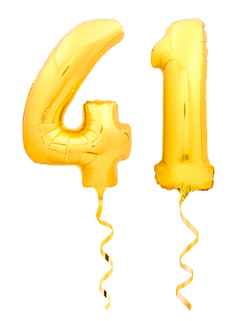 Golden number forty one 41 made of inflatable balloon with golden ribbon isolated on white background Stock Photo