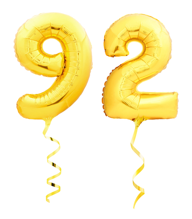 Golden number ninety two 92 made of inflatable balloon with golden ribbon isolated on white background Banque d'images