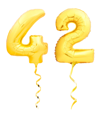 Golden number forty two 42 made of inflatable balloon with golden ribbon isolated on white background