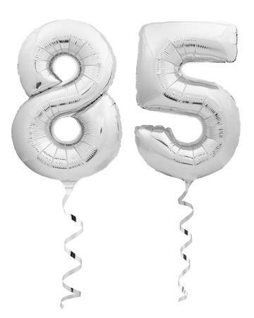 Silver chrome number eighty five 85 made of inflatable balloon with silver ribbon isolated on white background Stock Photo