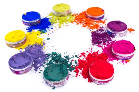 Colorful powder in small jars isolated on white background. Close-up shot Stock Photo
