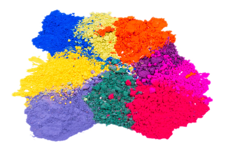 Closeup of colorful crushed makeup eyeshadow powder isolated on white background. Focus on a center of an image
