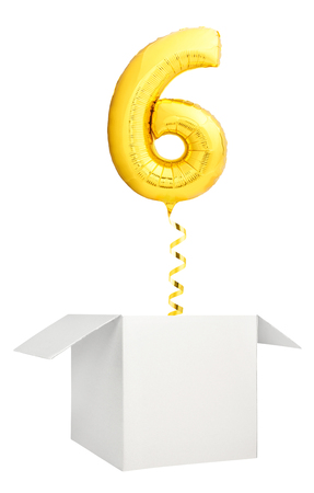 Golden number six inflatable balloon with golden ribbon flying out of blank white box isolated on white background