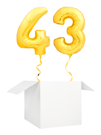 Golden number forty three inflatable balloon with golden ribbon flying out of blank white box isolated on white background. Birthday concept.