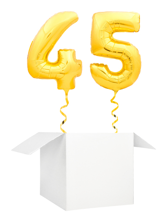 Golden number forty five inflatable balloon with golden ribbon flying out of blank white box isolated on white background. Birthday concept. 스톡 콘텐츠