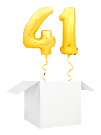 Golden number forty one inflatable balloon with golden ribbon flying out of blank white box isolated on white background. Birthday concept.