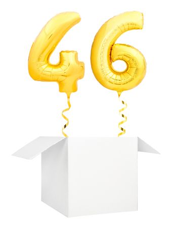 Golden number forty six inflatable balloon with golden ribbon flying out of blank white box isolated on white background. Birthday concept.
