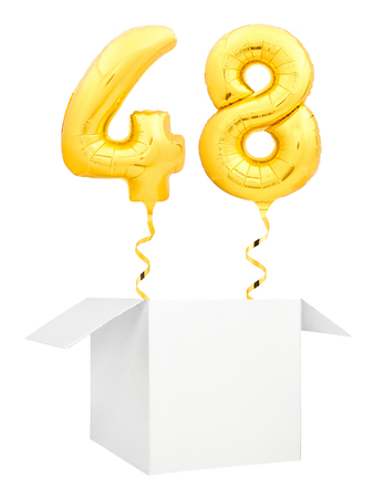 Golden number forty eight inflatable balloon with golden ribbon flying out of blank white box isolated on white background. Birthday concept. 스톡 콘텐츠 - 117194116