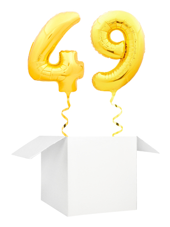 Golden number forty nine inflatable balloon with golden ribbon flying out of blank white box isolated on white background. Birthday concept. 스톡 콘텐츠