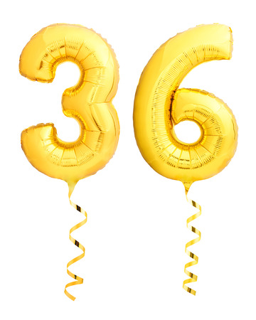 Golden number thirty six 36 made of inflatable balloon with golden ribbon isolated on white background