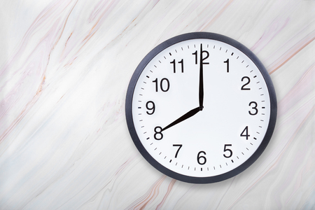 Wall clock show eight oclock on marble texture. Office clock show 8pm or 8am on marble texture with natural pattern