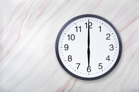 Wall clock show six oclock on marble texture. Office clock show 6pm or 6am on marble texture with natural pattern