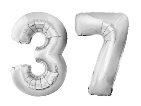 Number 37 thirty seven made of silver inflatable balloons isolated on white background. Chrome silver helium balloons forming 37 thirty seven. Birthday concept