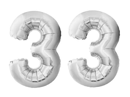 Number 33 thirty three made of silver inflatable balloons isolated on white background. Chrome silver helium balloons forming 33 thirty three. Birthday concept
