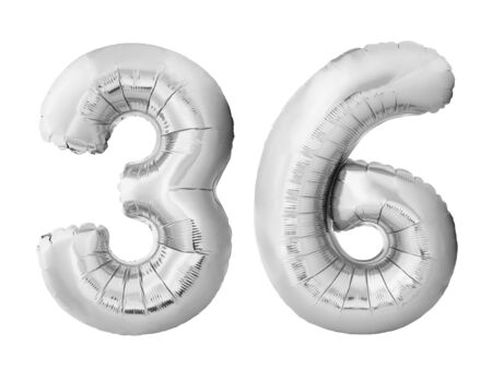 Number 36 thirty six made of silver inflatable balloons isolated on white background. Chrome silver helium balloons forming 36 thirty six. Birthday concept Stock Photo