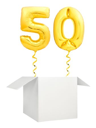 Golden number fifty inflatable balloon with golden ribbon flying out of blank white box isolated on white background 写真素材