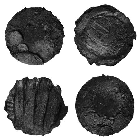 Set of four black paint samples isolated on a white background. Black round paint swatches 写真素材