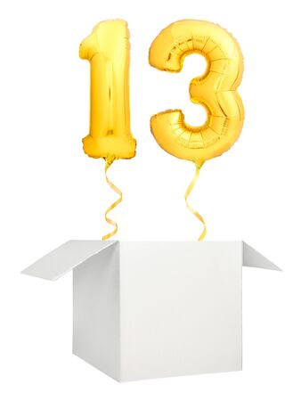 Golden number thirteen inflatable balloon with golden ribbon flying out of blank white box isolated on white background Stock Photo