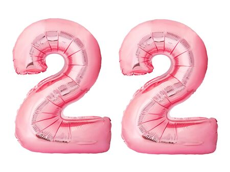 Number 22 twenty two made of rose gold inflatable balloons isolated on white background. Pink helium balloons forming 22 twenty two number