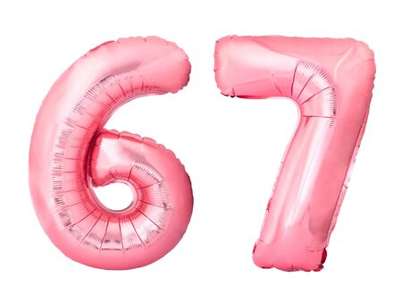 Number 67 sixty seven made of rose gold inflatable balloons isolated on white background. Pink helium balloons forming 67 sixty seven number