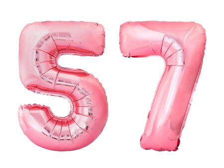 Number 57 fifty seven made of rose gold inflatable balloons isolated on white background. Pink helium balloons forming 57 fifty seven number