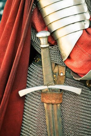 Medieval knight. Close-up of sword and armor