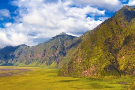 Beautiful mountains against blue sky with clouds. Bromo Tengger Semeru National Park, East Java, Indonesia