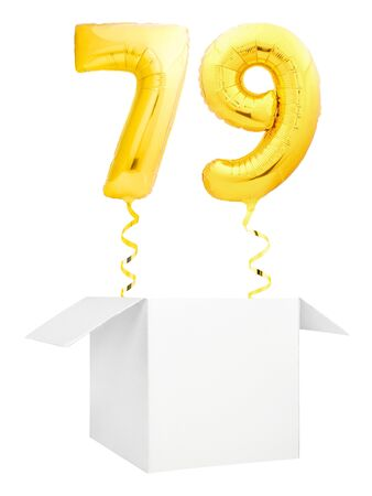 Golden number seventy nine inflatable balloon with golden ribbon flying out of blank white box isolated on white background. Birthday concept.