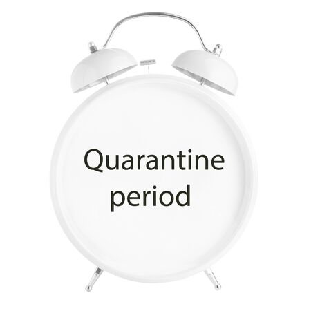 White twin bell alarm clock with Quarantine period sign isolated on white background. Lockdown or quarantine concept