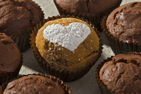 Chocolate muffin powdered sugar heart shape photo