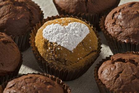 Chocolate muffin powdered sugar heart shape photo