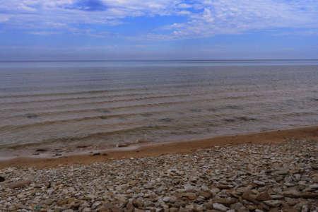 peacefull: Coastline: blue sky and waves Stock Photo