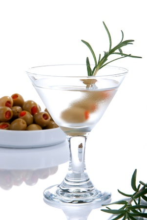Classic Martini with olives filled by red papper inside and rosmarin isolated on a white background Stock Photo - 8286377